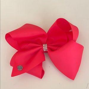 A big hot pink jojo hair bow.